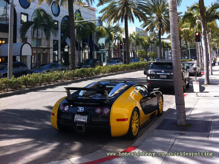 bijan 39 s yellow bugatti veyron on rodeo drive parked outside his store. Black Bedroom Furniture Sets. Home Design Ideas